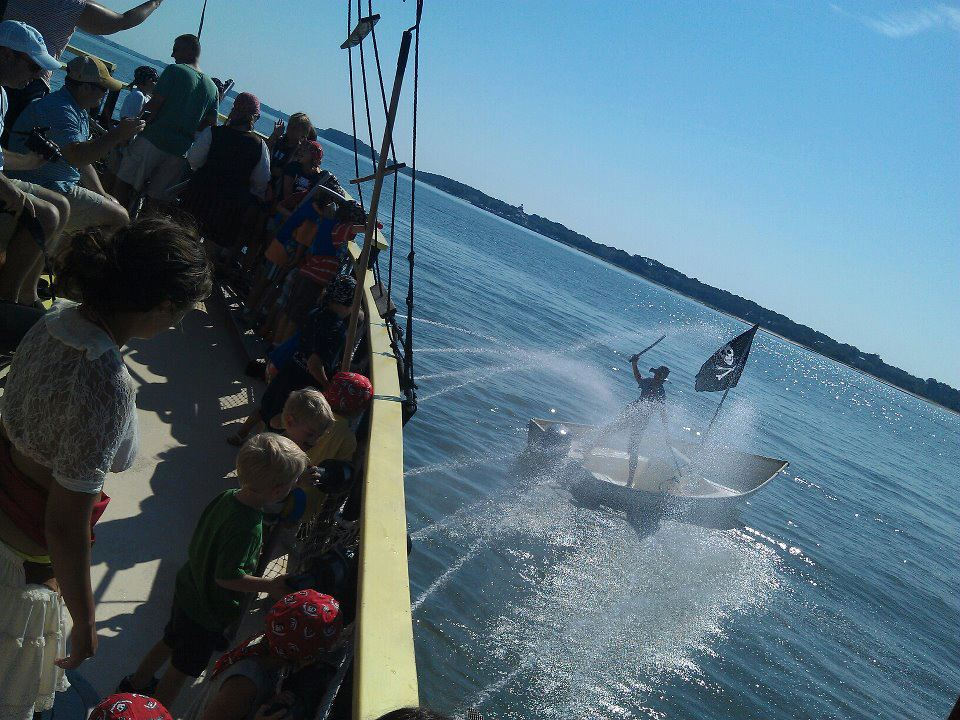 Water cannons shooting at pirate on dinghy