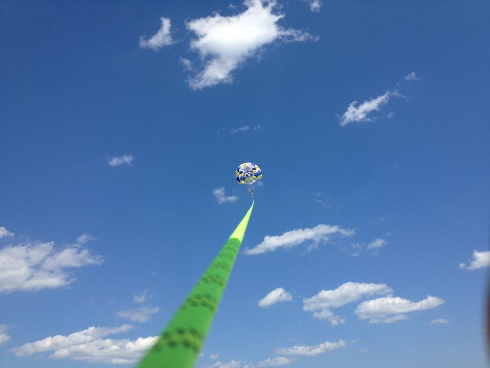 Get a bird s eye view of the island go parasailing for Fish camp hilton head