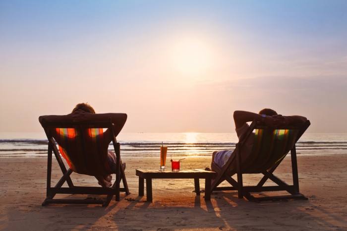 Couple-relaxing-on-beach-chairs